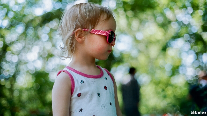 The child with the sunglasses