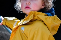 The child with the yellow jacket